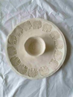 a-biscuit-fired-piece-ready-for-glazing